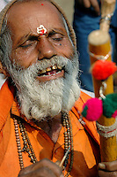"""India, Nasik, 2006. A """"sadhu'"""" or traveling holy man, sings for his supper at the Ramkund, pilgrimage site for many religious Hindus."""