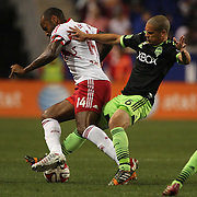 Thierry Henry, (left), New York Red Bulls, is tackled by Osvaldo Alonso, Seattle Sounders, during the New York Red Bulls Vs Seattle Sounders, Major League Soccer regular season match at Red Bull Arena, Harrison, New Jersey. USA. 20th September 2014. Photo Tim Clayton