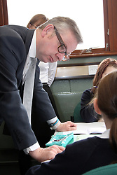 ©Licensed to London News Pictures. 04/04/2014<br /> Brooke Weston Academy, Corby, Northamptonshire. Secretary of State for Education Michael Gove MP visiting Brooke Weston Academy in Corby as part of a fact finding tour of free schools. Pictured, Michael Gove MP with pupils learning Spanish, in Modern Languages class<br /> Photo credit: Steven Prouse/ LNP