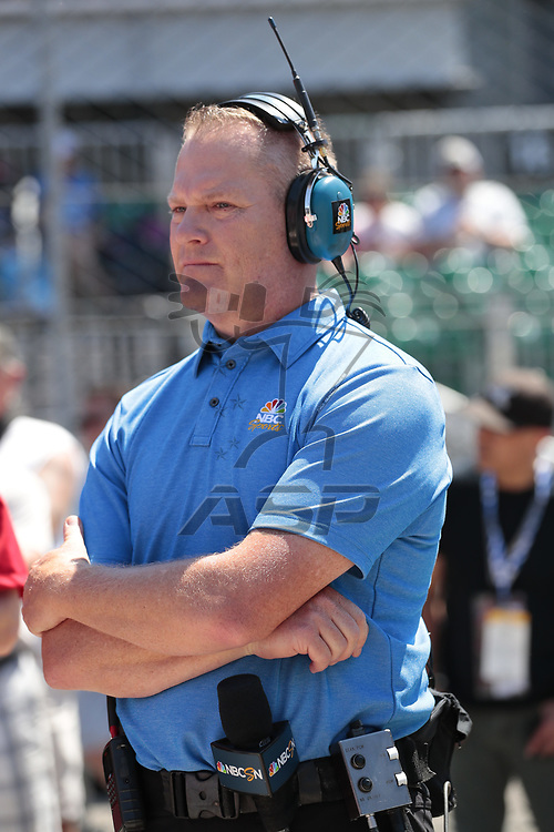 Announcer and commentator, Marty Snider, watches as the NTT IndyCar Series teams prepare to qualify for the Indianapolis 500 at Indianapolis Motor Speedway in Indianapolis, Indiana.