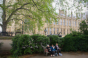 Women eating a picnic on a bench under the Palace of Westminster in central London.