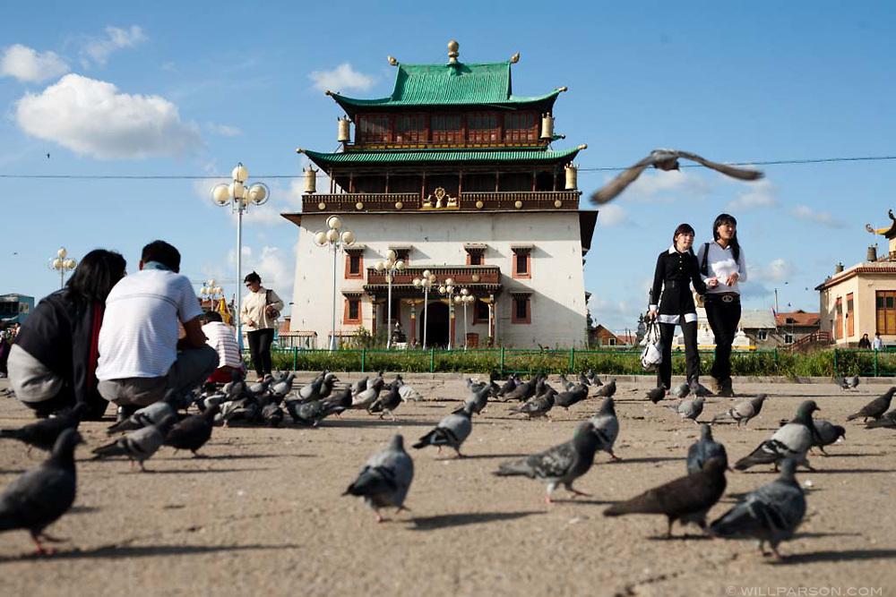 Visitors feed pigeons in Gandantegchinleng Khiid Buddhist Monastery in Ulaanbaatar.