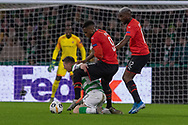Theoson Siebatcheu (9) of Rennes fouls Celtics Callum McGregor (#42) during the Europa League match between Celtic and Rennes at Celtic Park, Glasgow, Scotland on 28 November 2019.