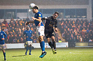 Macclesfield Town defender Theo Vassell head the ball during the EFL Sky Bet League 2 match between Macclesfield Town and Mansfield Town at Moss Rose, Macclesfield, United Kingdom on 16 November 2019.