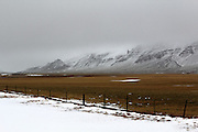Clouds hang over the mountains that line the middle of the Snaefellsnes Peninsular in Western Iceland