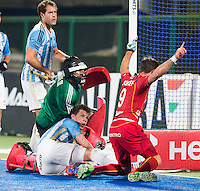 RAIPUR (India) -  Sébastien Dockier (Belg.) scores for Belgium.  Lucas Rossi (Arg) and goalie Juan Vivaldi (Arg) can't stop him Hockey World League Final  men (Quarterfinals)  .  Argentina v Belgium (1-2)  .    © WSP / Koen Suyk