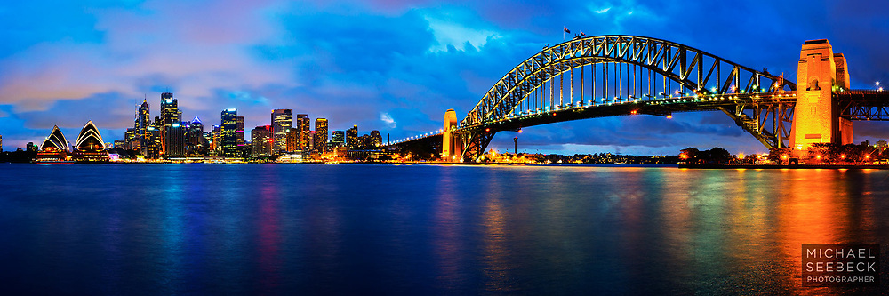 This photograph features a long exposure at twilight of Sydney and its Harbour Bridge and Opera House.<br /> <br /> Code: HANM0001<br /> <br /> Limited Edition of 125 Prints