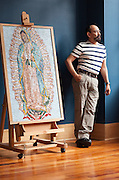 Artist Hector Hernandez stands next to his mosaic of The Virgen de Guadalupe at the Erikson Gallery where his art will be exhibited until June 30th as part of the Saints & Sinners Rose City Art Show. He is working on another mosaic of the  Virgen de Guadalupe similar to this one that will be on permament dispaly at The Grotto. <br /> Image by Shauna Intelisano