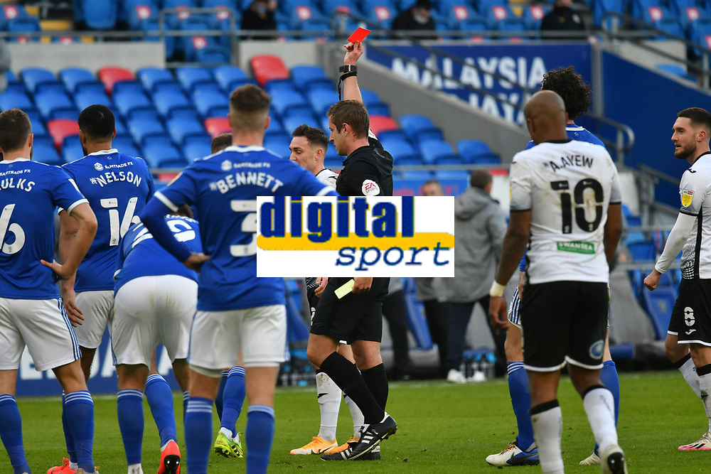 Football - 2020 / 2021 Sky Bet Championship - Cardiff City vs Swansea City - Cardiff City Stadium<br /> <br />  Referee J Brooks referee shows a red carrot Joe Ralls of Cardiff Cityin a stadium without fans because of the pandemic crisis<br /> <br /> COLORSPORT/WINSTON BYNORTH