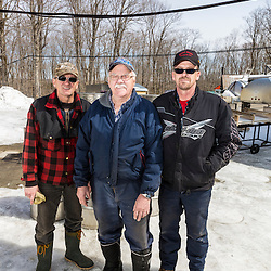 Three members of the LaRiviere family at their sugarhouse in Big Six Township, Maine. Their family has crossed the border from Quebec to produce syrup on this sugarbush since 1903.