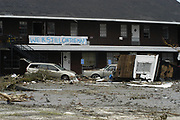 Residents of  Bay St. Louis Mississippi hand a sign  outside their home after hurricane katrina destroyed downtown olde town in bay st. louis.sludge in their neighbor while walking their dog past what used to be St. Augustines Retreat.Tuesday August 31,2005. Waveland was in Hancock county and was one of the hardest hit communities.Hurricane Katrina is the worst natural disaster to hit america.(photo/Suzi Altman)
