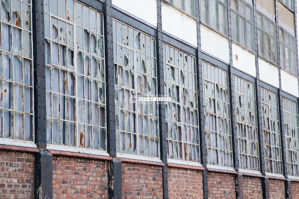 Vandalised bricked up windows in a factory at Bootle; Liverpool; England,