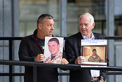 © Licensed to London News Pictures . 06/07/2016 . London , UK . The families of those killed in the Iraq war arrive at the QEII Centre . Scene outside the Queen Elizabeth II Conference Centre in Westminster , ahead of the publication of the Chilcot Inquiry's report in to the 2003 invasion of Iraq . Photo credit : Joel Goodman/LNP