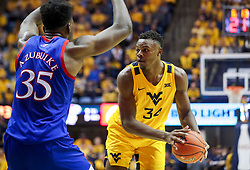 Feb 12, 2020; Morgantown, West Virginia, USA; West Virginia Mountaineers forward Oscar Tshiebwe (34) looks to pass while defended by Kansas Jayhawks center Udoka Azubuike (35) during the second half at WVU Coliseum. Mandatory Credit: Ben Queen-USA TODAY Sports