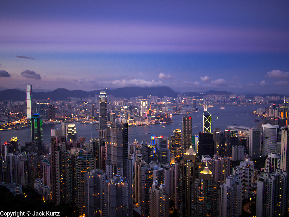 11 AUGUST 2013 - HONG KONG: Looking across to Kowloon from Victoria Peak in Hong Kong at sunset. Hong Kong is one of the two Special Administrative Regions of the People's Republic of China, Macau is the other. It is situated on China's south coast and, enclosed by the Pearl River Delta and South China Sea, it is known for its skyline and deep natural harbour. Hong Kong is one of the most densely populated areas in the world, the  population is 93.6% ethnic Chinese and 6.4% from other groups. The Han Chinese majority originate mainly from the cities of Guangzhou and Taishan in the neighbouring Guangdong province.      PHOTO BY JACK KURTZ