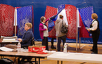 Brenda Currier (seated), Joanne Gianni and Kathy Brooks work the polls at Gilmanton Elementary School as a steady stream of voters come through Tuesday afternoon.  (Karen Bobotas/for the Laconia Daily Sun)