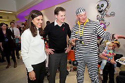 © London News Pictures. 31/10/2013 . London, UK.  Deputy Prime Minister NICK CLEGG and his wife MIRIAM GONZALEZ DURANTEZ talk to an entertainer while meeting children, parents and volunteers at the Great Ormond Street Hospital annual Halloween party.  Photo credit : Ben Cawthra/LNP