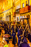 Hooded Penitents (Nazarenos) in the procession of the Brotherhood (Hermandad) El Baratillo, Holy Week (Semana Santa), Seville, Andalusia, Spain.