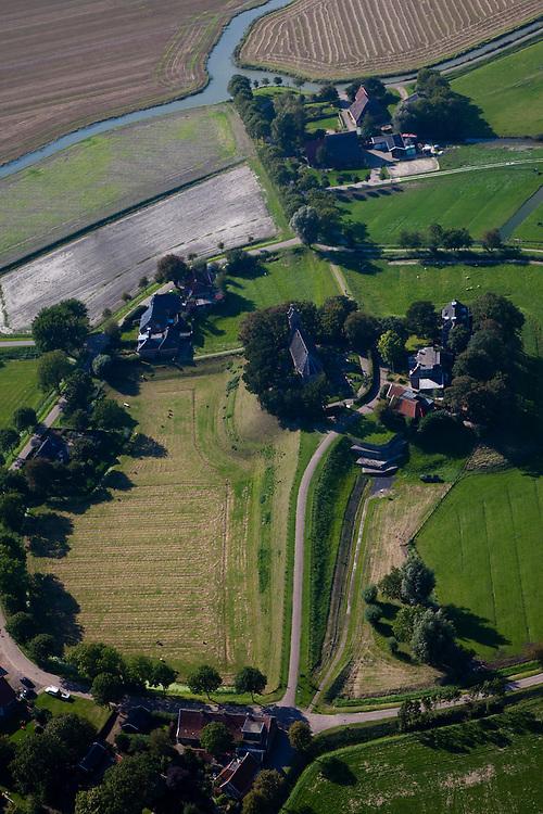 Nederland, Friesland, Gemeente Ferweradeel, 08-09-2009; Hogebeintum (Fries: Hegebeintum),  terpdorp. De terp is de hoogste van Friesland, maar alleen het deel met het kerkje heeft de oorspronkelijke hoogte, de rest van de terp is afgegraven, de vruchtbare grond diende als mest..Hogebeintum (Fries: Hegebeintum), mound village. The terp (mound) is the highest of Friesland, but only the part with the church has the original height, the rest of the mound has been excavated, the fertile ground served as fertilizer.luchtfoto (toeslag); aerial photo (additional fee required); .foto Siebe Swart / photo Siebe Swart