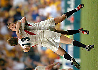 Photo: Richard Lane.<br />Australia v England. Rugby World Cup Final, at the Telstra Stadium, Sydney. RWC 2003. 22/11/2003. <br />Jonny Wilkinson celebrates on the whistle with Will Greenwood.