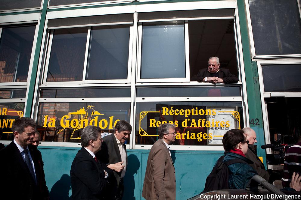 21032012. Campagne présidentielle 2012. Jean-Luc Mélenchon en déplacement à Bobigny sur le thème des services publics et à Gennevilliers sur le thème du logement insalubre.