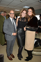Left to right, STANLEY TUCCI, FELICITY BLUNT and LADY NATASHA FINCH at the 2015 Hennessy Gold Cup held at Newbury Racecourse, Berkshire on 28th November 2015.
