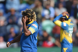 Sri Lanka's Lasith Malinga reacts as a catch is dropped during the ICC Champions Trophy, Group B match at Cardiff Wales Stadium.