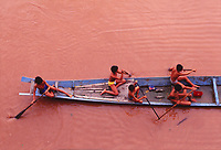 boys canoeing in the Mekong River