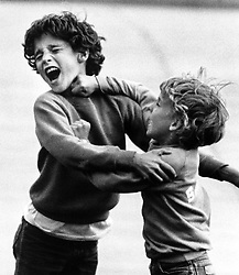 """Ten-year-old Justin Trudeau gets a right hook from his kid brother, eight-year-old Alexandre """"Sacha"""" Trudeau, as the two await the arrival of their father, Prime Minister Pierre Trudeau, at the airport in Ottawa on Sunday, June 13, 1982. The two kept themselves busy by playfully fighting as their dad made his way home from a ten-day European trip. Sacha later got a bruised lip. THE CANADIAN PRESS/Peter Bregg /ABACAPRESS.COM    521043_004 Ottawa Canada"""