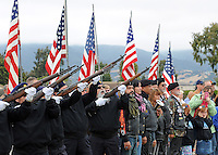 The honor guard from American Legion Post 31 fires a three-volley salute during the annual Avenue of Flags Memorial Day Program at Garden of Memories Memorial Park in Salinas.