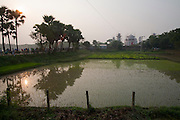 A view of the Taj Mahal Bangladesh, a replica of India's famed Taj Mahal erected by Ahsanullah Moni, a millionaire film director and businessman in the rice fields near his home village outside of Dhaka, Bangladesh. He says he built it because most  Bangladeshi people cannot afford the trip to Agra, India to see the real thing. The entry fee for his replica is 50 Taka, about  0.75 USD. There is a 25-room hotel facing the Bangla Taj and he says his plans include a film studio and center nearby. The construction of the main Taj will be completed in about a month but the tourist attraction is now open to the public. Moni claims about 20,000 people visit daily. There is only a single lane two kilometer road winding through the surrounding rice fields connecting the main road to his attraction, near the town of Sonargaon, about 30 kilometers from Dhaka.