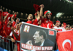 Fans of Turkey celebrate victory against head coach of Croatia Slaven Bilic after the UEFA EURO 2008 Quarter-Final soccer match between Croatia and Turkey at Ernst-Happel Stadium, on June 20,2008, in Wien, Austria.  Won of Turkey after penalty shots. (Photo by Vid Ponikvar / Sportal Images)