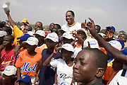MLB Hall of Famer Dave Winfield stands among a group of children after an exhibition baseball game in the city of Tema, roughly 35 km east of Ghana's capital Accra on Saturday February 3, 2007. The game was being held on the occasion of the visit of a delegation from the American Major League Baseball Association made possible by the African Development Foundation, a non-profit organization that supports little league projects in selected African countries.
