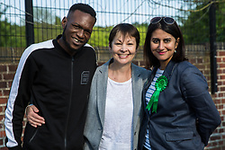 London, UK. 22 May, 2019. Caroline Lucas (c), Green Party MP for Brighton Pavilion, campaigns for the European elections in Gipsy Hill, Lambeth, with Gulnar Hasnain, who is on the Green Party list in London. After Gibraltar, Lambeth is the most pro-Remain area of the UK with 78.6% having voted Remain in 2016. There was a large swing to the Green Party in Gipsy Hill, historically a safe Labour seat, in May 2018 when Pete Elliott was elected as a Green councillor.