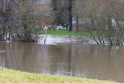 © Licensed to London News Pictures. 16/12/2020. Builth Wells, Powys, Wales, UK. After recent heavy rainfall, the river Wye bursts it's banks at Builth Wells in Powys, Wales, UK. There are Meteorological office yellow warnings for rain in South Wales, UK for the next few days. Photo credit: Graham M. Lawrence/LNP