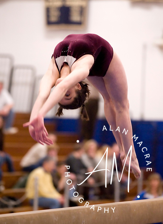 Concord's Kaelyn Bouchard performs on the balance beam during Saturday's tournament at Salem High School.  (Alan MacRae/for the Monitor)