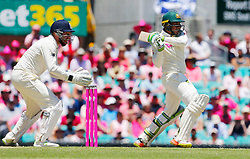 Australia's Usman Khawaja plays a shot as Jonny Bairstow looks on during day two of the Ashes Test match at Sydney Cricket Ground.