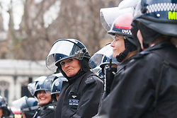 Whitehall, London, April 4th 2015. As PEGIDA UK holds a poorly attended rally on Whitehall, scores of police are called in to contain counter protesters from various London anti-fascist movements. PICTURED: Mounted police officers wait to be called in to support police lines in Whitehall as scuffles further up the road continue.