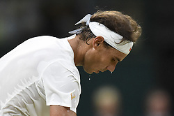 LONDON, July 14, 2018  Rafael Nadal of Spain competes during the men's singles semifinal match against Novak Djokovic of Serbia at the Wimbledon Championships 2018 in London, Britain, on July 13, 2018. The match was suspended due to the time issue. (Credit Image: © Stephen Chung/Xinhua via ZUMA Wire)