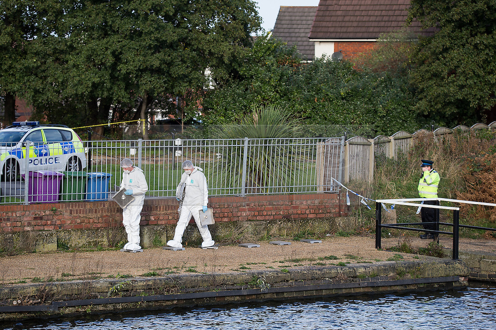 © Licensed to London News Pictures . 16/11/2015 . Liverpool , UK . Scene by the Leeds-Liverpool Canal in the Eldonian Village area of Liverpool where a 16 year old boy was shot dead last night (15th November 2015 ) . Photo credit: Joel Goodman/LNP