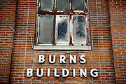 SHOT 9/6/13 2:33:05 PM - Detail of the Burns Building, a residential apartment/condo buidling, on 25 Huron Street in downtown Buffalo, N.Y. Buffalo is the second most populous city in the state of New York and is located in Western New York on the eastern shores of Lake Erie and at the head of the Niagara River. By 1900, Buffalo was the 8th largest city in the country, and went on to become a major railroad hub, the largest grain-milling center in the country and the home of the largest steel-making operation in the world. The latter part of the 20th Century saw a reversal of fortunes: by the year 1990 the city had fallen back below its 1900 population levels. (Photo by Marc Piscotty / © 2013)