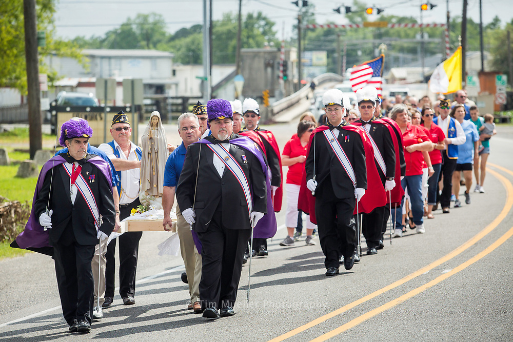 Members of the Knights of Columbus from across Louisiana escort a statue of Our Lady of Fatima to Virgin Island in Pierre Part, La. Saturday, May 13, 2017. The Church commemorated the 100th anniversary of our Lady of Fatima's first appearance. Beginning with a procession from the church to Virgin Island, parishioners honored Mary with a May Crowning and Mass. Virgin Island is a small island across the bayou from the church dedicated to the Blessed Mother. The parishioners of St. Joseph the Worker have a strong devotion to Mary and believe the Blessed Mother has intervened over the years to save lives in many natural disasters. Each year, weather permitting, Mass is held on the island on the second Saturday of May and second Saturday of October.