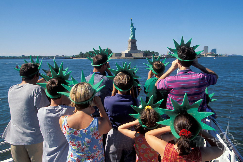 Tourist wearing liberty crown en route to the Statue of Liberty