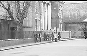 Dr Herrema Kidnap Trial Begins.    K9..1976..23.02.1976..02.23.1976..23rd February 1976..After a period of incarceration, the trial of Eddie Gallagher finally got under way at the Special Criminal Court, Green Street, Dublin. Gallagher was charged with the kidnap of the Dutch Industrialist, Dr Tiede Herrema. The kidnap ended with the release of Dr Herrema after a siege at Monasterevin, Co Kildare...Image shows family and friends of the accused waiting for their arrival at the court.