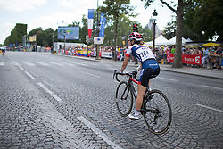Gabrielle Pilote-Fortin (CAN) of Cervélo-Bigla Cycling Team rides back to the team bus after finishing the La Course, a 89 km road race in Paris on July 24, 2016 in France.