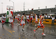 """Photo by Alex Jones..The Rio Grande Valley Silverados and the Reynosa Correcaminos play an exhibition basketball game in the middle of the Hidalgo - Reynosa International Bridge on Tuesday morning.  The game shut down traffic into Mexico for 15 minutes, and prompted McAllen Mayor Richard Cortez to wonder out loud, """"Where else can you possibly do this other than the border?"""""""