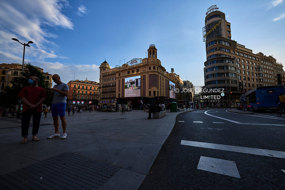 """Side-walk restaurants, cafes and bars are allowed to open after 72 days closed due to the coronavirus crisis, once Madrid today have entered so-called """"Phase One"""" on May 25, 2020 in Madrid, Spain. <br /> People wearing a protective face shield or mask as new still life.<br /> Some parts of Spain have entered the so-called """"Phase One"""" or """"Phase Two"""" transitions from its coronavirus lockdown, allowing many shops to reopen as well as restaurants who serve customers outdoors. Locations that were harder hit by coronavirus (Covid-19), such as Madrid and Barcelona, remain in a stricter quarantine."""