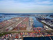 Nederland, Zuid-Holland, Rotterdam, 14-09-2019; Tweede Maasvlakte (MV2),  Hartelhaven (voorgrond), Amazonehaven, met ECT Delta Terminal(containers) en Mississippihaven met EMO (overslag droge bulk, zoals erts en kolen). <br /> Second Maasvlakte (MV2), Maasvlakte Plaza. Amazonehaven, with ECT Delta Terminal (containers) and Mississippihaven with EMO (transshipment of dry bulk, such as ore and coal). <br /> <br /> luchtfoto (toeslag op standard tarieven);<br /> aerial photo (additional fee required);<br /> copyright foto/photo Siebe Swart