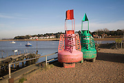 Red and green marine navigation buoys, Felixstowe Ferry, Suffolk, England