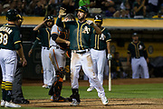Oakland Athletics right fielder Matt Joyce (23) celebrates a two-run home run against the San Francisco Giants at Oakland Coliseum in Oakland, California, on August 1, 2017. (Stan Olszewski/Special to S.F. Examiner)